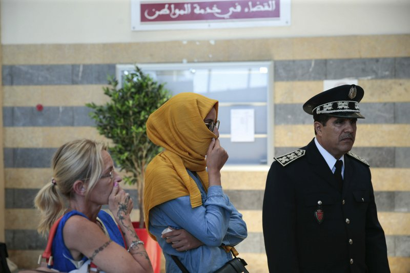 Gema Guervos, left, mother of Spanish-Swiss suspect Kevin Zoller Guervos, and his wife, right, stand outside a court room after a trial session for suspects charged in connection with killing of two Scandinavian tourists in Morocco's Atlas Mountains, in Sale, near Rabat, Morocco, Thursday, May 16, 2019. (AP Photo/Mosa'ab Elshamy)