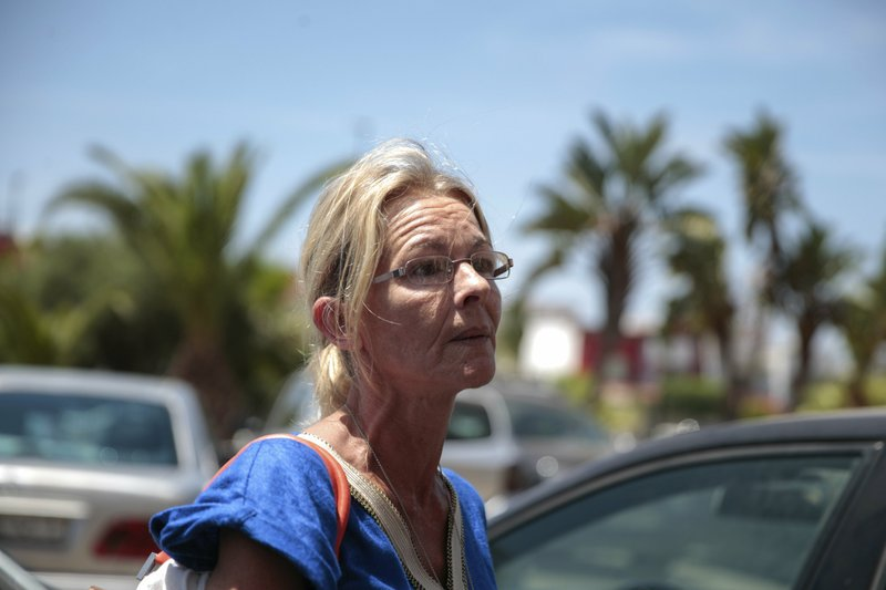Gema Guervos, mother of Spanish-Swiss suspect Kevin Zoller Guervos, speaks to the press after a trial session for suspects charged in connection with killing of two Scandinavian tourists in Morocco's Atlas Mountains, in Sale, near Rabat, Morocco, Thursday, May 16, 2019. (AP Photo/Mosa'ab Elshamy)
