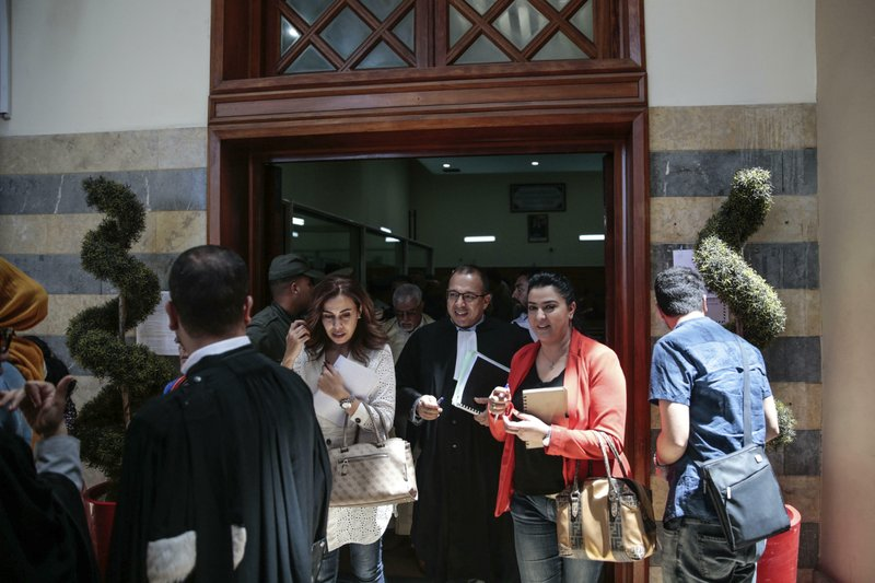 People leave a court room after a trial session for suspects charged in connection with killing of two Scandinavian tourists in Morocco's Atlas Mountains, in Sale, near Rabat, Morocco, Thursday, May 16, 2019. (AP Photo/Mosa'ab Elshamy)