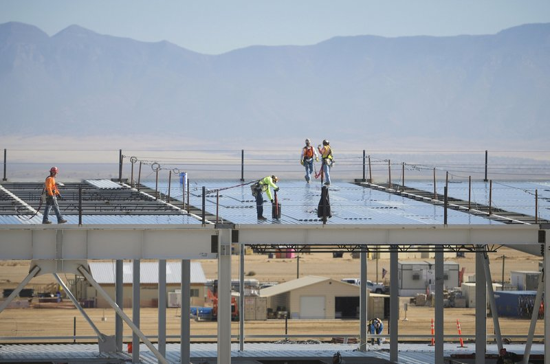 FILE - In this Nov. 14, 2017, file photo, construction workers build one of the Facebook data center buildings in Los Lunas, N. (Marla Brose/The Albuquerque Journal via AP, File)