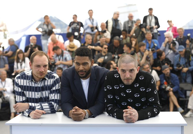 Actors Alexis Manenti, from left, Djebril Zonga and Damien Bonnard pose for photographers at the photo call for the film 'Les Miserables' at the 72nd international film festival, Cannes, southern France, Thursday, May 16, 2019. (AP Photo/Petros Giannakouris)