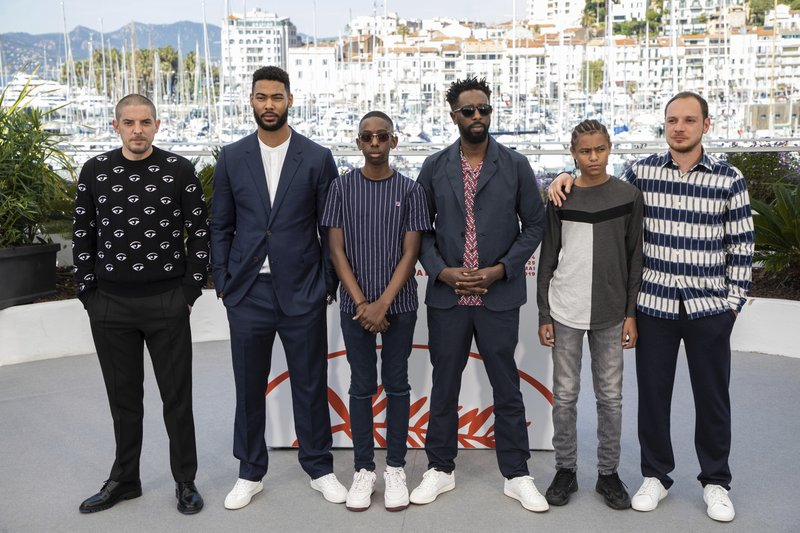 Actors Damien Bonnard, from left, Djebril Didier Zonga, Al Hassan Ly, director Ladj Ly, actors Issa Perica and Alexis Manenti pose for photographers at the photo call for the film 'Les Miserables' at the 72nd international film festival, Cannes, southern France, Thursday, May 16, 2019. (Photo by Vianney Le Caer/Invision/AP)