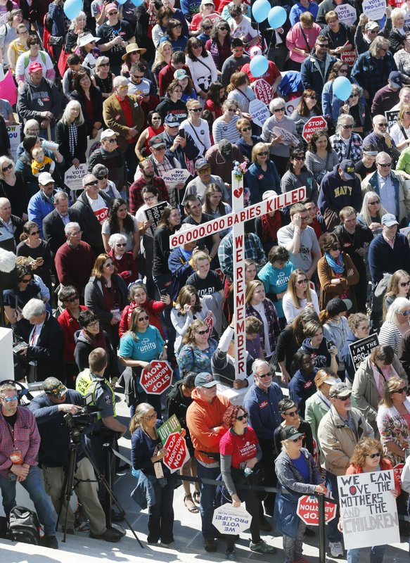FILE - In this April 3, 2019, file photo, Right to Life marchers gather on the steps of the Capitol to listen to speakers  in Richmond, Va. (AP Photo/Steve Helber, File)
