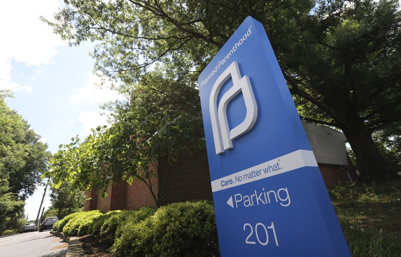 FILE - This May 15, 2019, file photo shows a sign in front of the Planned Parenthood offices in Richmond, Va. (AP Photo/Steve Helber, File)