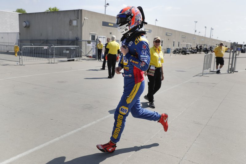 Alexander Rossi runs to the pit area during practice for the Indianapolis 500 IndyCar auto race at Indianapolis Motor Speedway, Wednesday, May 15, 2019, in Indianapolis. (AP Photo/Michael Conroy)