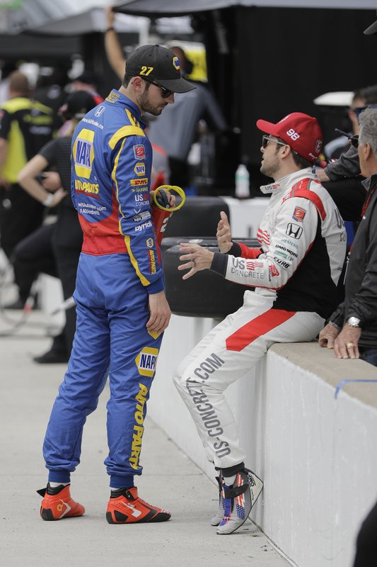 Alexander Rossi, left, talks with Marco Andretti during practice for the Indianapolis 500 IndyCar auto race at Indianapolis Motor Speedway, Tuesday, May 14, 2019, in Indianapolis. (AP Photo/Darron Cummings)