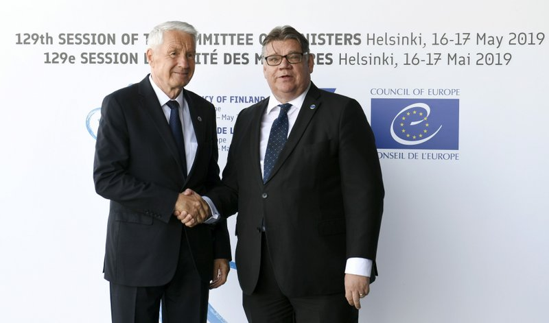 Foreign Minister of Finland Timo Soini, right, welcomes Secretary General of the Council of Europe Thorbjorn Jagland to the Commemoration Ceremony of the 70th anniversary of the Council of Europe in Helsinki, Finland, Thursday May 16, 2019. (Martti Kainulainen/Lehtikuva via AP)