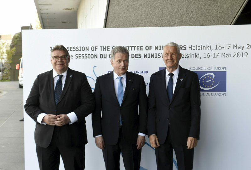 Foreign Minister of Finland Timo Soini, left, and Secretary General of the Council of Europe Thorbj'rn Jagland, right, welcome Finland's President Sauli Niinist' to the Commemoration Ceremony of the 70th anniversary of the Council of Europe in Helsinki, Finland, Thursday May 16, 2019. (Martti Kainulainen/Lehtikuva via AP)