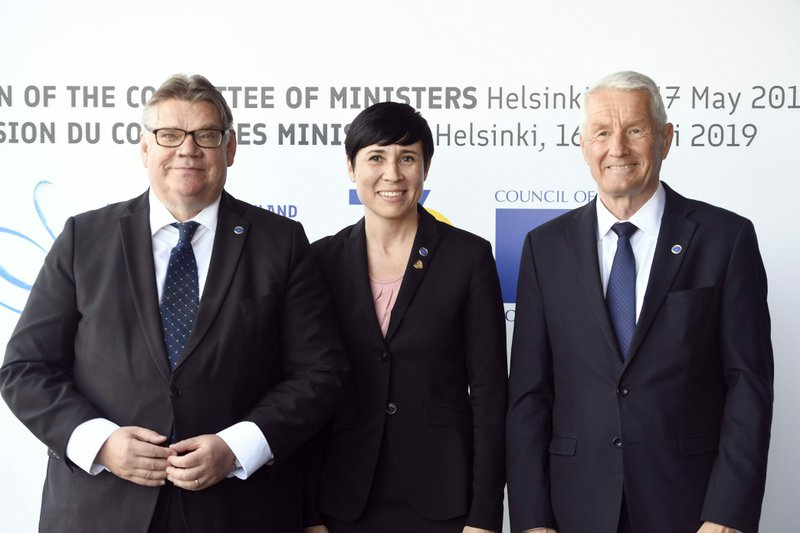 Foreign Minister of Finland Timo Soini, left, and Secretary General of the Council of Europe Thorbj'rn Jagland, right, welcome Norway's Foreign Minister Ine Marie Eriksen Soreide to the Commemoration Ceremony of the 70th anniversary of the Council of Europe in Helsinki, Finland, Thursday May 16, 2019. (Martti Kainulainen/Lehtikuva via AP)