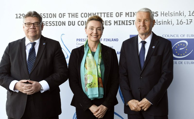 Foreign Minister of Finland Timo Soini, left, Croatia's Foreign Minister Marija Pejcinovic Buric and Secretary General of the Council of Europe Thorbjorn Jagland, right, pose for the media at the Commemoration Ceremony of the 70th anniversary of the Council of Europe in Helsinki, Finland, Thursday May 16, 2019. (Martti Kainulainen/Lehtikuva via AP)