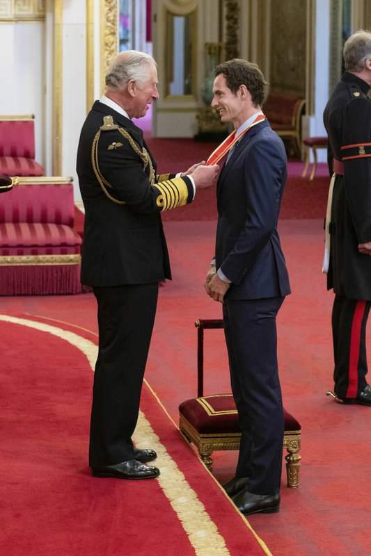 Britain's Andy Murray receives his knighthood from Prince Charles during an investiture ceremony at Buckingham Palace, London, Thursday May 16, 2019. (Dominic Lipinski/PA via AP)