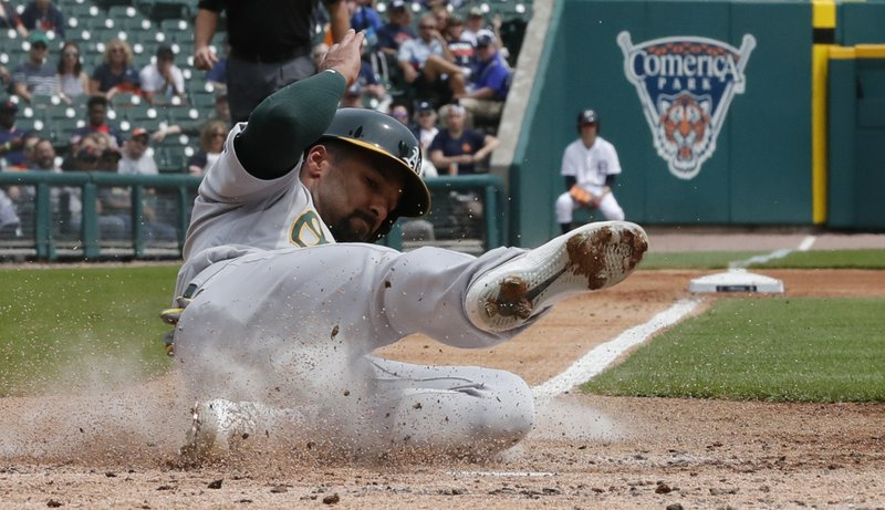 Oakland Athletics' Marcus Semien scores from third on a wild pitch during the third inning of a baseball game against the Detroit Tigers, Thursday, May 16, 2019, in Detroit. (AP Photo/Carlos Osorio)