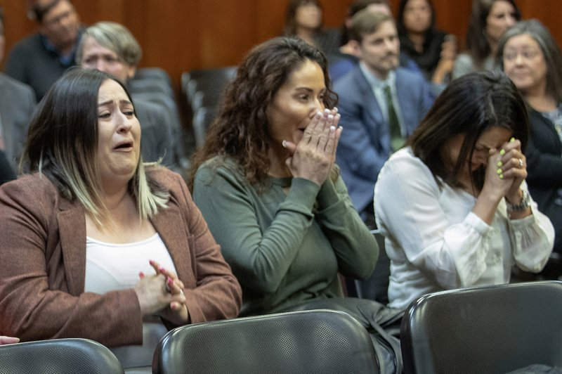 In this Wednesday, May 15, 2019 photo, relatives of Lionel Rubalcava react in a San Jose, Calif., courtroom as Judge Eric Geffon reverses his attempted murder conviction. (Karl Mondon/San Jose Mercury News via AP)