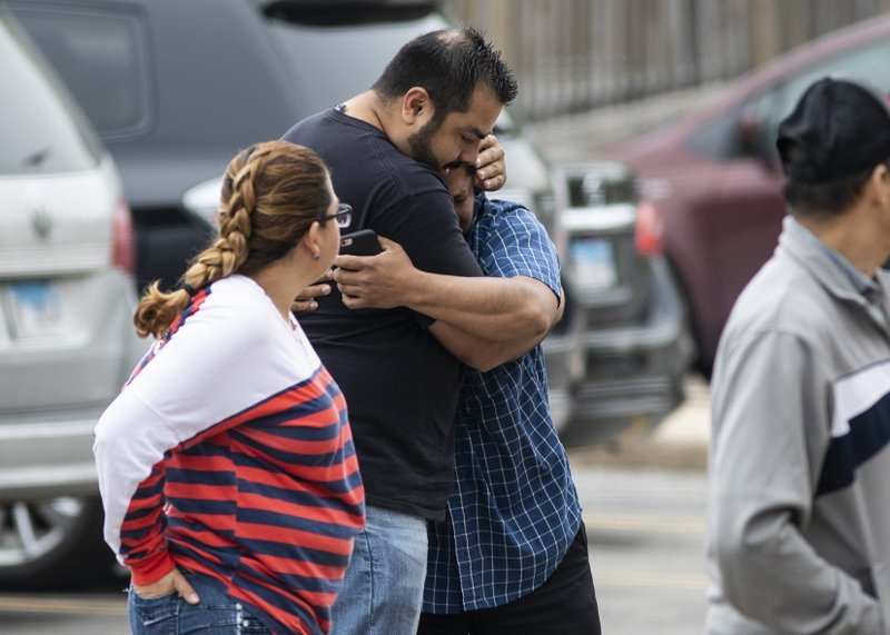 Arnulfo Ochoa, the father of Marlen Ochoa-Lopez, is comforted by a supporter as he walks into the Cook County medical examiner's office to identify his daughter's body, Thursday, May 16, 2019 in Chicago. (Ashlee Rezin/Chicago Sun-Times via AP)