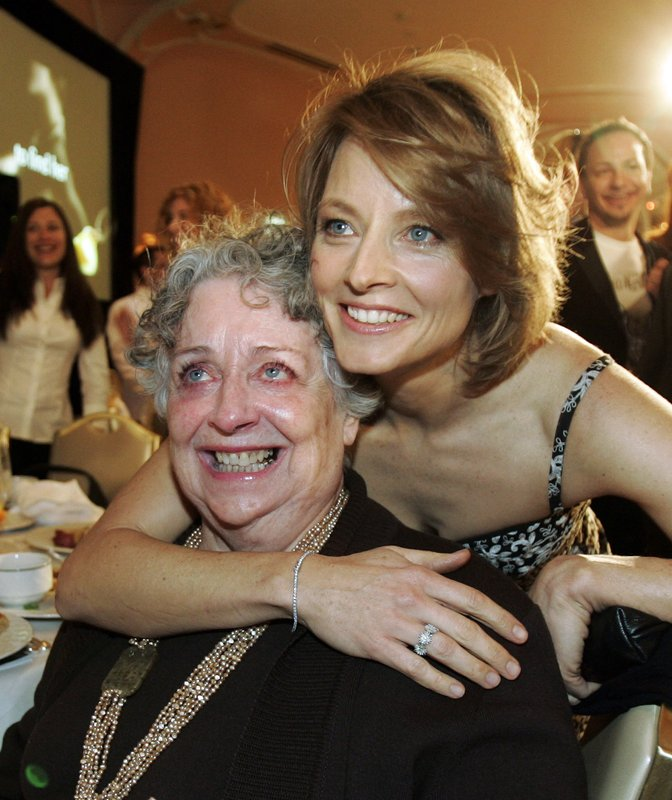 FILE - This Dec. 4, 2007 file photo shows actress-director Jodie Foster, right, with her mother Evelyn Foster after she received the Sherry Lansing Leadership Award at during the 16th annual Women in Entertainment breakfast in Beverly Hills, Calif. (AP Photo/Kevork Djansezian, File)