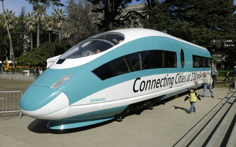 FILE - In this Feb. 26, 2015, photo, a full-scale mock-up of a high-speed train isdisplayed at the Capitol in Sacramento, Calif. (AP Photo/Rich Pedroncelli, File)