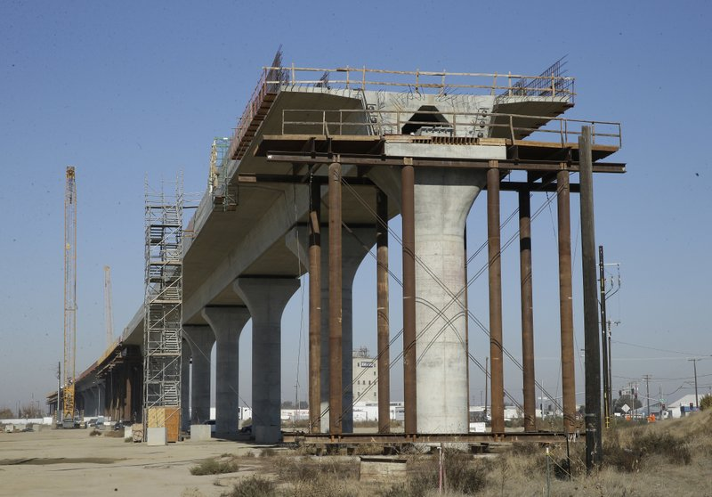 FILE - In this Dec. 6, 2017, file photo, one of the elevated sections of the high-speed rail is under construction in Fresno, Calif. (AP Photo/Rich Pedroncelli, File)