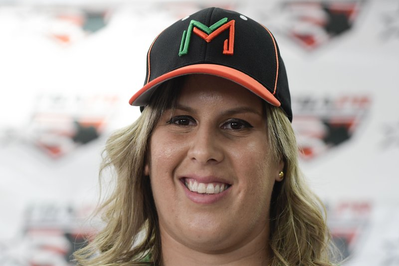 First baseman and member of the National Women's Baseball Team, Diamilette Quiles Alicea, is presented as the first female player to sign with The Utuado Highlanders, one of the teams that participate in the Superior Double A Baseball League, in San Juan, Puerto Rico, Thursday, May 16, 2019. (AP Photo/Carlos Giusti)