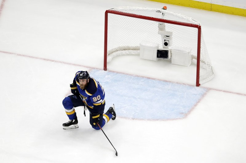 St. Louis Blues center Ryan O'Reilly (90) kneels by the net after the San Jose Sharks tied the game late in the third period of Game 3 of the NHL hockey Stanley Cup Western Conference final series Wednesday, May 15, 2019, in St. (AP Photo/Jeff Roberson)