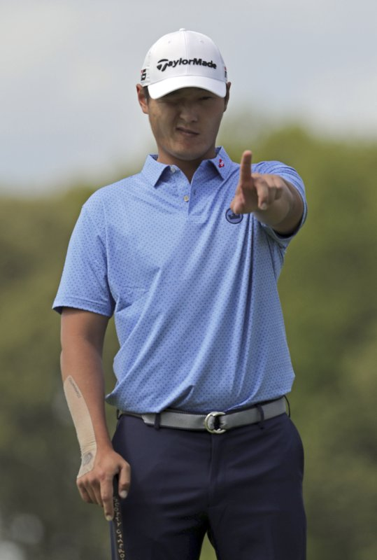 Danny Lee, of New Zealand, lines up a putt on the 11th green during the first round of the PGA Championship golf tournament, Thursday, May 16, 2019, at Bethpage Black in Farmingdale, N. (AP Photo/Charles Krupa)