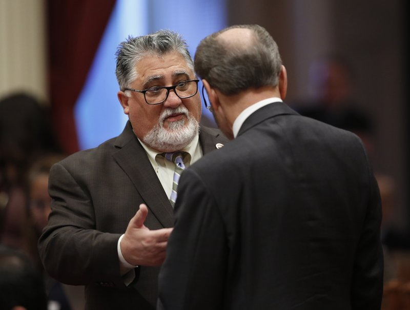 State Sen. Anthony Portantino, D-La Canada Flintridge, left, talks with Sen. Jerry Hill, D-San Mateo, right, during the Senate session at the Capitol Thursday, May 16, 2019, in Sacramento, Calif. (AP Photo/Rich Pedroncelli)