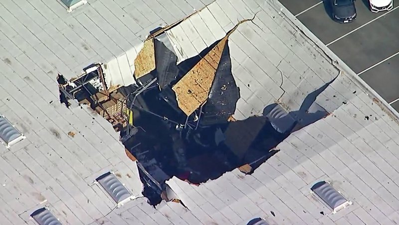 This photo taken from video provided by KABC-TV shows where an F-16 fighter jet crashed into a warehouse just outside March Air Reserve Base in Riverside, Calif., Thursday afternoon, May 16, 2019. Maj. Perry Covington, director of public affairs at the base, says the pilot ejected before the crash and was not hurt and there are no immediate reports of injuries on the ground. (KABC-TV via AP)