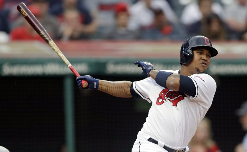 Cleveland Indians' Jose Ramirez watches his ball after hitting an RBI-single off Baltimore Orioles starting pitcher Dan Straily in the third inning of a baseball game, Thursday, May 16, 2019, in Cleveland. Carlos Santana scored on the play. (AP Photo/Tony Dejak)