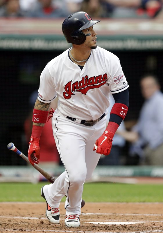 Cleveland Indians' Carlos Gonzalez hits an RBI-single off Baltimore Orioles starting pitcher Dan Straily in the third inning of a baseball game, Thursday, May 16, 2019, in Cleveland. Francisco Lindor scored on the play. (AP Photo/Tony Dejak)