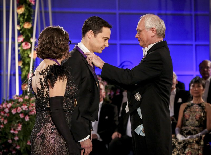 This photo provided by CBS shows Mayim Bialik, left, and Jim Parsons, center, in a scene from the series finale of
