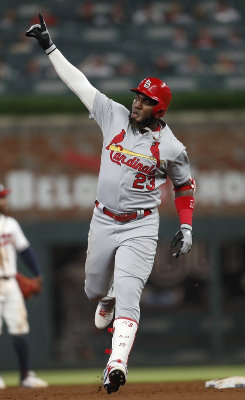 St. Louis Cardinals' Marcell Ozuna gestures as he rounds the bases after hitting a solo home run in the sixth inning of the team's baseball game against the Atlanta Braves on Thursday, May 16, 2019, in Atlanta. (AP Photo/John Bazemore)
