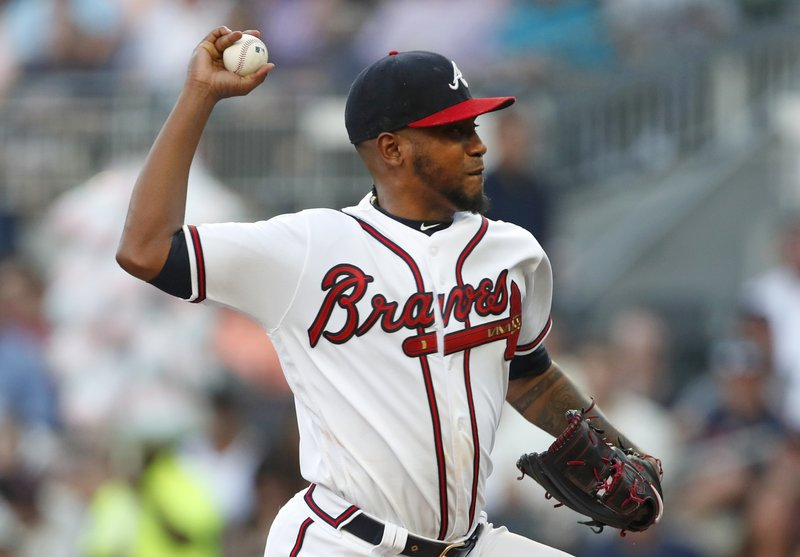 Atlanta Braves starting pitcher Julio Teheran (49) works against the St. Louis Cardinals in the first inning of a baseball game Thursday, May 16, 2019, in Atlanta. (AP Photo/John Bazemore)