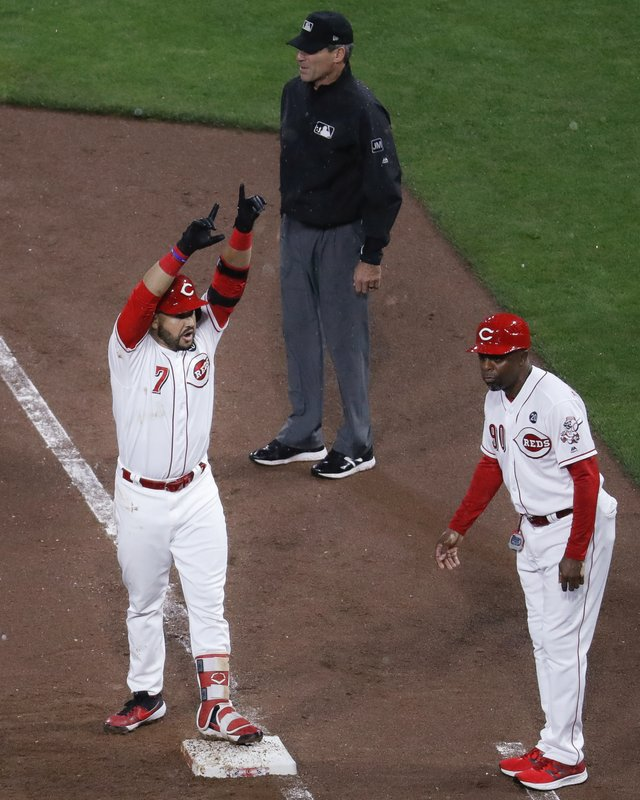 Cincinnati Reds' Eugenio Suarez (7) celebrates after hitting an RBI single off Chicago Cubs starting pitcher Jose Quintana during the fifth inning of a baseball game Thursday, May 16, 2019, in Cincinnati. (AP Photo/John Minchillo)