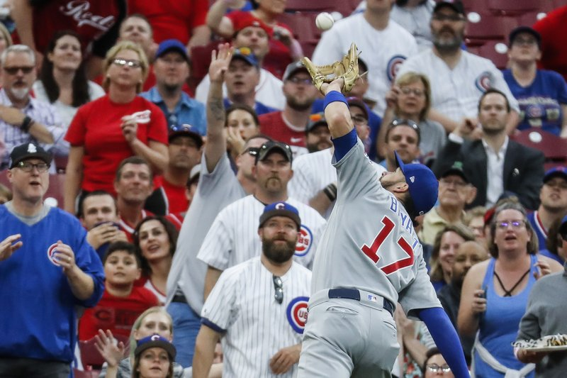 Chicago Cubs' Kris Bryant catches a pop fly by Cincinnati Reds' Joey Votto during the first inning of a baseball game Thursday, May 16, 2019, in Cincinnati. (AP Photo/John Minchillo)
