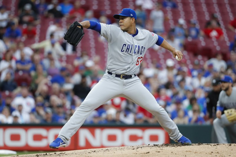 Chicago Cubs starting pitcher Jose Quintana throws during the first inning of the team's baseball game against the Cincinnati Reds on Thursday, May 16, 2019, in Cincinnati. (AP Photo/John Minchillo)