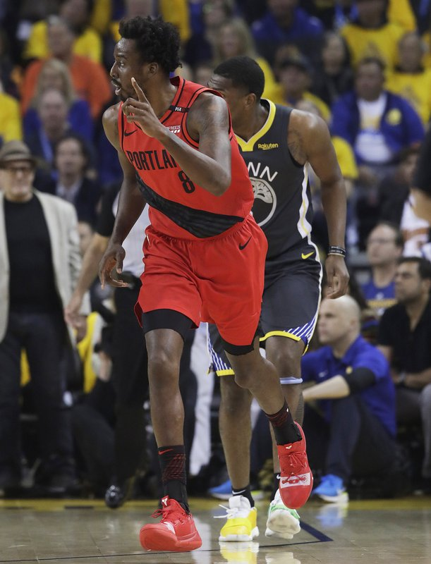 Portland Trail Blazers forward Al-Farouq Aminu (8) gestures after scoring against the Golden State Warriors during the first half of Game 2 of the NBA basketball playoffs Western Conference finals in Oakland, Calif., Thursday, May 16, 2019. (AP Photo/Jeff Chiu)