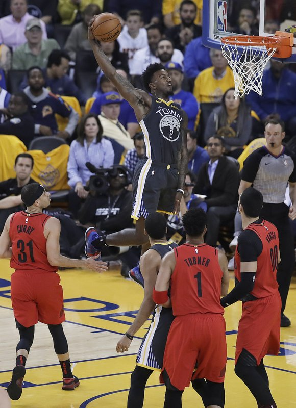 Golden State Warriors forward Jordan Bell (2) dunks against the Portland Trail Blazers during the first half of Game 2 of the NBA basketball playoffs Western Conference finals in Oakland, Calif., Thursday, May 16, 2019. (AP Photo/Ben Margot)