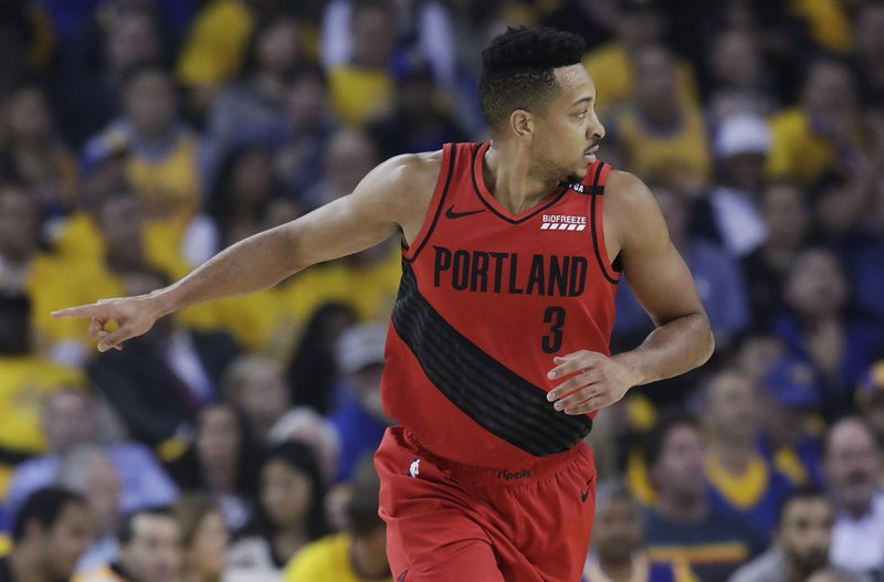Portland Trail Blazers guard CJ McCollum gestures after scoring against the Golden State Warriors during the first half of Game 2 of the NBA basketball playoffs Western Conference finals in Oakland, Calif., Thursday, May 16, 2019. (AP Photo/Jeff Chiu)