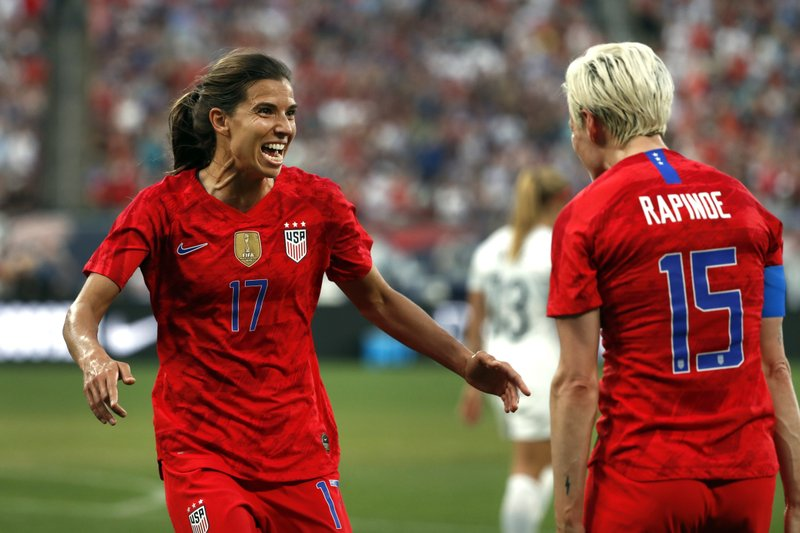 United States' Tobin Heath, left, is congratulated by teammate Megan Rapinoe after scoring during the first half of an international friendly soccer match against New Zealand Thursday, May 16, 2019, in St. Louis. (AP Photo/Jeff Roberson)