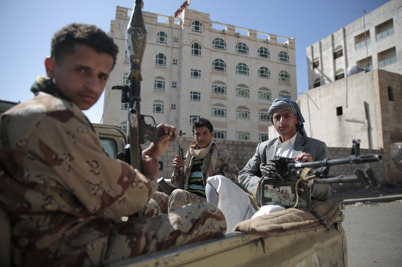 FILE - This Apr. 19, 2017 file photo, Shiite fighters, known as Houthis, pose for a photo as they secure a road, as people take part in a march from Sanaa to the port city of Hodeidah, Yemen. From Lebanon and Syria to Iraq, Yemen, and the Gaza Strip, Iran has significantly expanded its footprint over the past decade, finding and developing powerful allies in conflict-ravaged countries across the Middle East. Iran supports the Houthis but denies arming them. (AP Photo/Hani Mohammed, File)