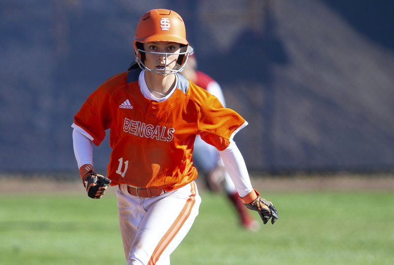 FILE - In this Feb. 8, 2019, file photo, Idaho State's Haley Harrison leads off second base during an NCAA softball game in Fullerton, Calif. Harrison was taught all her life to be mentally strong, never show any weakness. It helped the Idaho State senior on the softball field, but wreaked havoc on her mind as she struggled with mental illness. (AP Photo/ Daniel Bowyer, File)