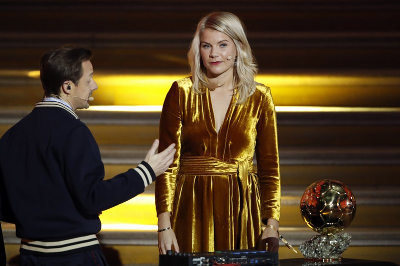 FILE - In this Monday Dec. 3, 2018 file photo, French DJ and musician Martin Solveig, left, talks to Olympique Lyonnais' Ada Hegerberg, of Norway, during the Ballon d'Or award ceremony at the Grand Palais in Paris. After asking the first woman to win the Ballon d'Or if she twerked, French DJ Martin Solveig then said sorry. UEFA launched its five-year development plan for women's soccer Friday May 17, 2019, in a breakthrough season leading to the World Cup in France. The strategy document, Time for Action, sets out how the European soccer body aims to double the number of women and girls playing, and change perceptions of their game. (AP Photo/Christophe Ena, File)