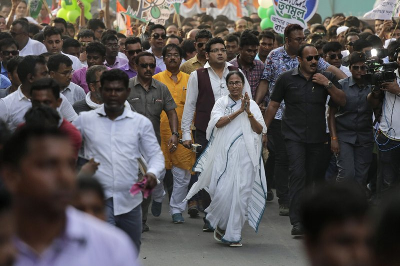 FILE- In this Friday, May 10, 2019 file photo, Trinamool Congress party leader and Chief Minister of West Bengal state Mamata Banerjee greets the crowd during an election campaign rally in Kamarhati, about 25 kilometers north of Kolkata, India. India's Prime Minister Narendra Modi has taken his Bharatiya Janata Party's fight to the state of West Bengal, where it hopes to retain a majority in staggered general elections concluding this week by diluting the strength of a formidable opponent, chief minister Mamata Banerjee. (AP Photo/Bikas Das, File)
