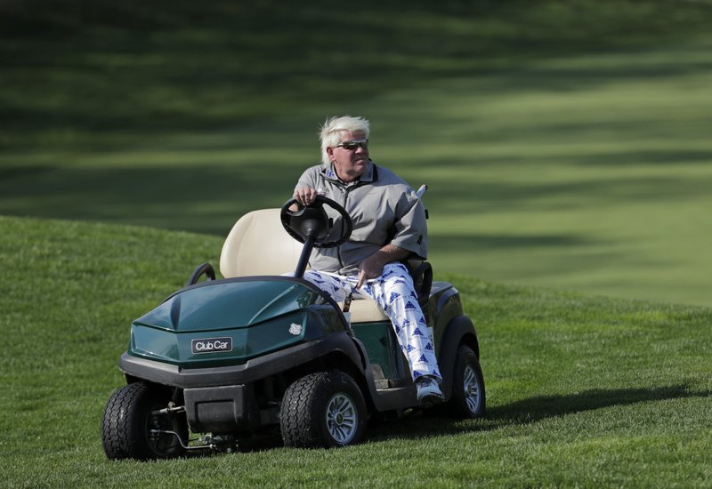 John Daly gets in his golf cart after putting on the fifth green during the second round of the PGA Championship golf tournament, Friday, May 17, 2019, at Bethpage Black in Farmingdale, N.Y. (AP Photo/Julio Cortez)