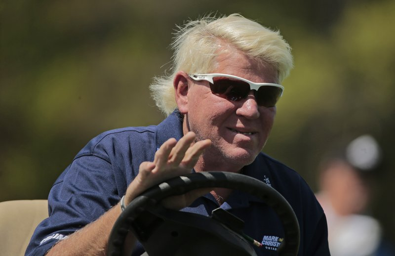 John Daly waves to golf fans as he drives down the 16th fairway during the first round of the PGA Championship golf tournament, Thursday, May 16, 2019, at Bethpage Black in Farmingdale, N.Y. (AP Photo/Andres Kudacki)