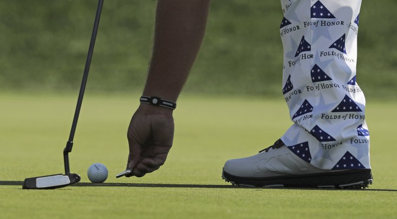 John Daly marks his ball on the 11th green during the second round of the PGA Championship golf tournament, Friday, May 17, 2019, at Bethpage Black in Farmingdale, N.Y. (AP Photo/Charles Krupa)