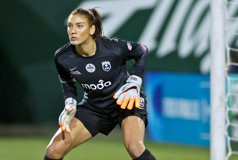 FILE - In this Oct. 1, 2015, file photo, Seattle Reign FC goalkeeper Hope Solo follows the action during the second half of the NWSL soccer championship match in Portland, Ore. Solo was in goal four years ago in Canada when the United States won soccer's most prestigious tournament. She has no regrets about her acrimonious breakup with the team, which will seek to defend its title at the Women's World Cup in France.  (AP Photo/Craig Mitchelldyer, File)