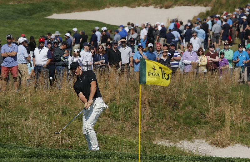 Rory McIlroy, of Northern Ireland, chips onto the 16th green during the second round of the PGA Championship golf tournament, Friday, May 17, 2019, at Bethpage Black in Farmingdale, N.Y. (AP Photo/Andres Kudacki)