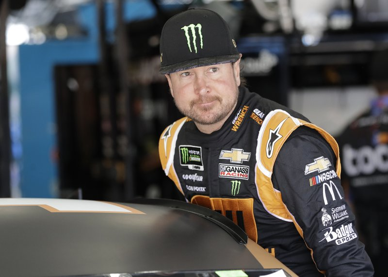 Kurt Busch climbs into his car before practice for Saturday's NASCAR All-Star Cup series auto race at Charlotte Motor Speedway in Concord, N.C., Friday, May 17, 2019. (AP Photo/Chuck Burton)