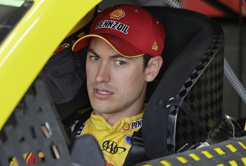 Joey Logano waits in his car before practice for Saturday's NASCAR All-Star Cup series auto race at Charlotte Motor Speedway in Concord, N.C., Friday, May 17, 2019. (AP Photo/Chuck Burton)