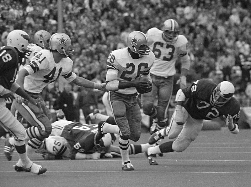 File- This Nov. 1, 1970 file photo shows Dallas Cowboys cornerback Herb Adderley (26) running after intercepting a Philadelphia Eagles pass in the fourth quarter of an NFL game in Dallas, Texas. Tom Brady will soon slip on his sixth Super Bowl ring, and Herb Adderley is the only other man on the planet who can relate to that level of success as the National Football League celebrates its 100th season.